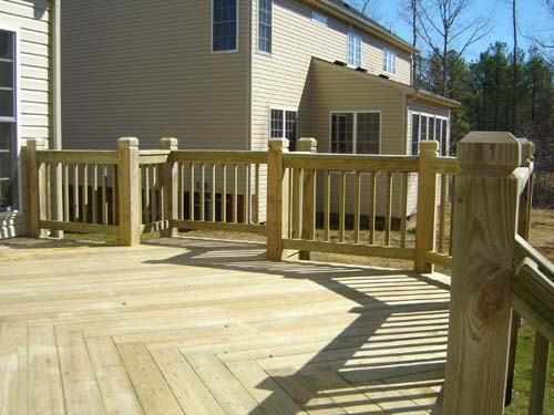 Wood or plastic home partners for Pressure treated decking